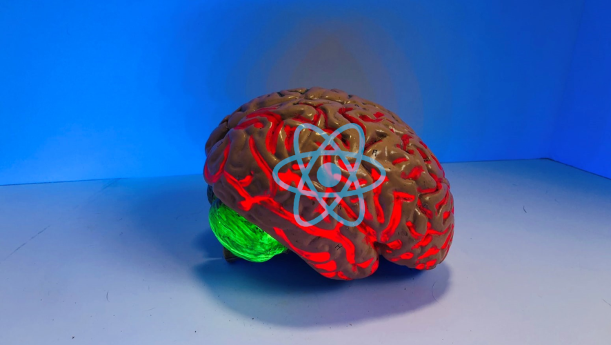 Photo of a plastic brain with React logo on it