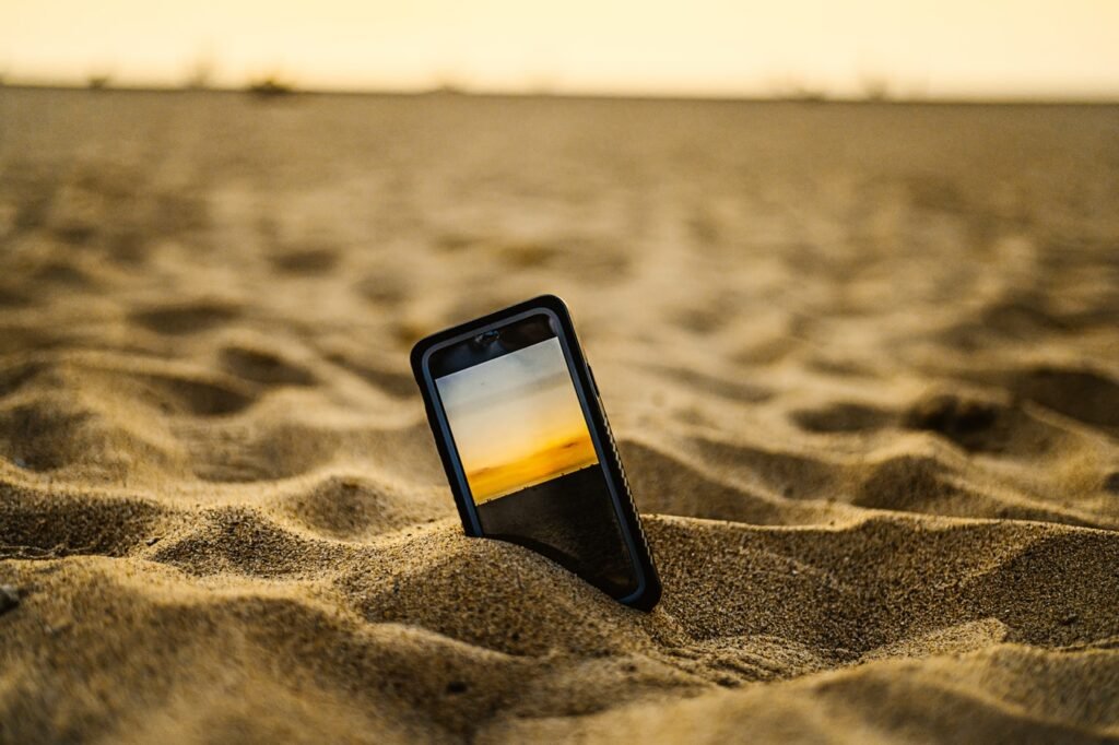 Phone in sand.